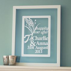Personalised wedding gift papercut : This wall art is an original papercut design which can be personalised to include the bride and grooms names as well as their wedding date. It has the added words 'Happily Ever After' to add a special touch to the whole design. It would make a perfect wedding gift for any couple getting married.  This design has been cut from artist quality 270gsm white card, but there are other colour choices - please have a look at the last image for the choices…