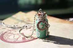 Alice in Wonderland Drink Me Inspired Necklace. $10.00, via Etsy.