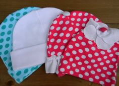 turn some out grown knit baby clothes into cute baby hats!