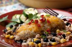 Cheesy topped chicken with Mexican rice Served with a quick spicy rice with beans and sweetcorn this chicken supper will certainly hit the spot. Chicken baked in the oven will keep moist and tender but don't overcook it or the flesh will dry