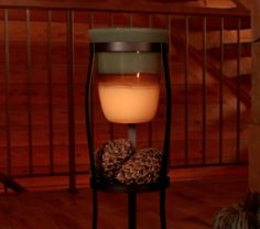 Cozy elegance: Tranquility Hurricane, Rustic Scroll Floor Stand and your favorite candle. #PartyLite
