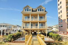 """Live the high life when you reserve Southern Hospitality for your next vacation. Brand new for 2013, this amazing beach house in North Myrtle Beach sleeps 28 people. It is an 8bdrm,0 8.5baths all with walk-in showers. Equipped with an elevator, surround sound system, heated, swimming pool with laser lights, Jacuzzi tub, game room with a pool table, Xbox 360 on a 50"""" TV, and an air hockey table. Call 1-800-525-0225 for more information."""