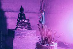 Srdjan Kirtic for Stocksy United - Buddha figurine in a small shrine.  ancient, balance, belief, bright, calm, colorful, content, deity, figurine, god, incense, light, lit, meditation, mindfulness, prayer, purple, religion, religious, sacred, sculpture, serene, shrine, spiritual, spirituality, statue, temple, vibrant, vivid, wat, worship, yoga, zen