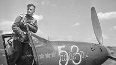 "Photo: Soviet pilot-as Nikolai Gulayev in the cockpit of his fighter P-39 ""Aerocobra"""