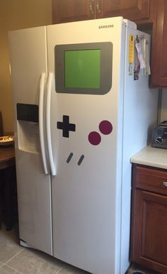 Game Boy Refrigerator Magnet Transforms Any Fridge Into A Nintendo Shrine - geek culture - Game Boy, All Video Games, Video Game Rooms, Video Game Decor, Man Cave Video Game Room, Deco Gamer, Geek Home Decor, Giant Games, Gamer Room