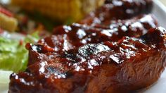 Simply seasoned ribs are boiled, then oven baked in the barbeque sauce of your choice for easy BBQ ribs.