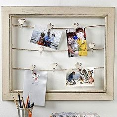 Picture frame with strands to hang pictures, postcards, recipes
