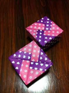 Cute Tomoko Fuse origami boxes in pink and purple patterned paper. Nonzdesign.com