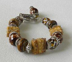 Leopard Cub Handmade Beaded Bracelet by bdzzledbeadedjewelry, $34.00