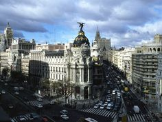 """Madrid's Gran Vía buzzes with activity 24/7, fronting shops from high-end to gritty and hotels for all budgets. Along the Vía you'll also find grand cinemas that host Spain's red carpet film premieres."" Photograph by Guido Cozzi/Atlantide/Corbis"