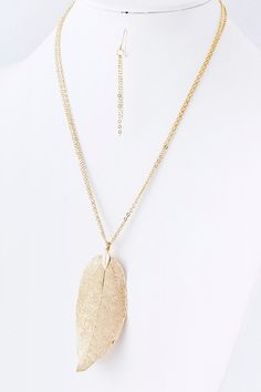 $49 Gorgeously delicate Leaf skeleton suspended from a double chain.