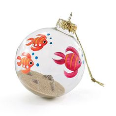 such a cute ornament!! fish painted on the outside & real sand and mini shells put inside!