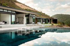 Architect John Maniscalco, has designed a home nestled into the hillside above the Silverado Trail, in Oakville, California.