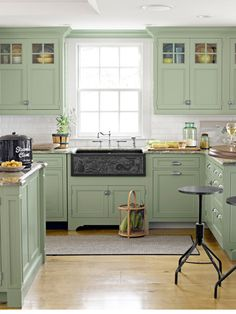 "Cabinets are painted a color similar to ""Green Crystal"" from Olympic.   Visit us at CountryLiving.com"