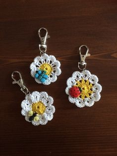 Crochet daisy bag charms/keyrings by QuirkyCornerEmporium on Etsy