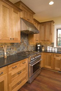 Large area of contrasting diamond tile--could work with rectangle tile?  Maybe frame area with same width of accent tile as accent strip?  Kitchen sink backsplash idea (Houzz)