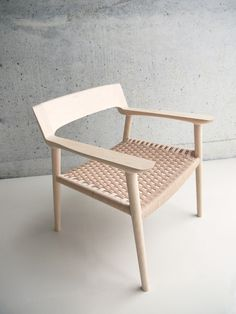 """Lounge Chair RU-LC002 by Ruskasa. The chair """"pretends"""" its seat is woven from rattan or leather, but it is carved wooden."""