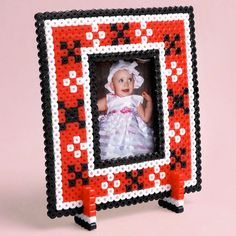 <p>Designed By Christy Gallaher</p>  <p>Our playful XOXO Frame is a colorful accent to display a wallet sized picture of your loved one. So easy to do with Perler Beads, you can make one for every special Valentine on your list! Perfect for any occasion.</p>