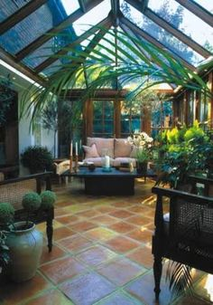 What a great sunroom! Especially love the tiled flooring to match the wooden beams.