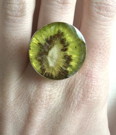 Real Kiwi Ring by realfruitjewelry on Etsy. This is made with actual real fruit put in some kind of resin? Making Resin Jewellery, Jewelry Making Tutorials, Resin Jewelry, Diy Jewelry, Jewelery, Resin Crafts, Resin Art, Resin Molds, Silicone Molds