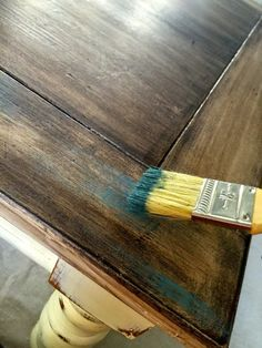 Dry Brush Over Stain  This table has quite the story. Three years ago, I bought it at a yard sale, for $15. Truthfully, it probably wasn't worth $5. It was in BAD shape but I was looking for a chunky, square table and it fit the description. I knew ASCP (Annie Sloan Chalk Paint) would fix it up and sure enough, it did the trick. I must admit that it was quite a challenge though. The table was covered in all kinds of nail polish, glue and other mystery substances. A month ago, I decided…