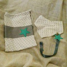 Diaper bag,bandana bib and pacifier clip.