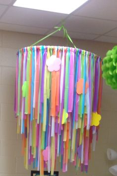 Ribbon Chandelier made from 2 different sized hoola hoops, strips of plastic tablecloths and flowers all from Walmart and The Dollar Tree. I came up with this inexpensive idea for my classroom. This kids LOVE IT!