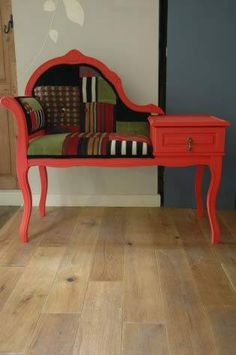 Old telephone bench given a bright red makeover.