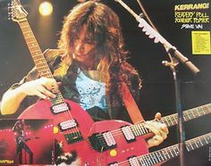 Great pic of Steve and his triple neck heart-shaped guitar!