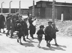 Jewish people just arriving at Auschwitz. They don't know it at the time but they were being walked to the gas chamber.