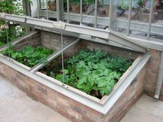 This is the gold standard of cold frames (photographed in London at the Chelsea Flower Show). Made of powder-coated aluminum by Alitex, one of England's premier greenhouse manufacturers, it's built to last for generations with a mortared brick base.