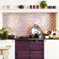 A purple-hued triple threat in an aubergine Aga stove, lavender tile backsplash (Marsh High Gloss Half Tiles from Residence range from the Winchester Tile Company), and plum kitchen accessories. Image via House to Home. Aga Kitchen, Kitchen Tiles, Country Kitchen, Kitchen Dining, Kitchen Decor, Shaker Kitchen, Rainbow Kitchen, Purple Kitchen, Kitchen Colors