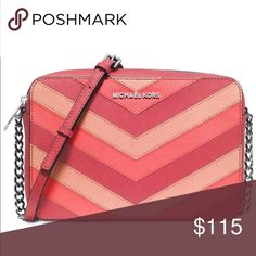🔻Price Drop🔻 Michael Kors Crossbody Perfect bag for Just about anything! Can be used as a crossbody or over the shoulder. Has a silver stainless steel chain. Colors are red and pink. Back has a bit of blue from jeans but nothing too noticeable. Michael Kors Bags Crossbody Bags