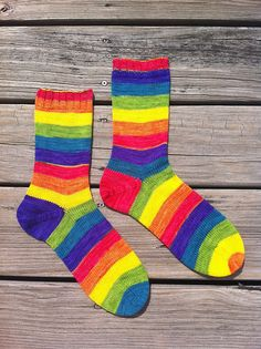 Ravelry: knittingumpy's Hayley's socks - Made with Tropical Rainbow Stripe Journey Sock Yarn hand dyed by The Painted Tiger.  Love her use of the afterthought heel to keep the stripes consistent on the front.