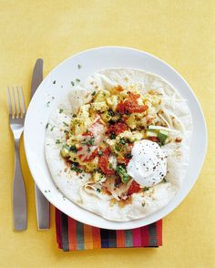 This popular dish is usually prepared with sunny-side up fried eggs; we made it with scrambled eggs to save time.