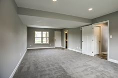 Sherwin Williams: Walls are Pussywillow, trim is Origami White. Floors: Shaw Life Elevated in Bird's Nest.