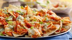 Get Buffalo Chicken Nachos Recipe from Food Network Healthy Buffalo Chicken Dip, Buffalo Chicken Nachos, Buffalo Chicken Dip Recipe, Buffalo Chicken Sandwiches, Buffalo Cauliflower, Cauliflower Bites, Totchos Recipe, Chicken Nachos Recipe, Chicken Recipes