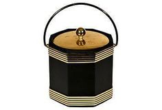 1970s black and gilt accented ice bucket.
