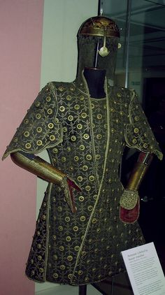 Chilta hazar masha (Coat of a thousand nails), kulah khud (helmet), bazu band (arm guards). Indian armored clothing made from layers of fabric faced with velvet and studded with numerous small brass nails, which were often gilded. The padded coat, minus its nails, is known for short as a chilta and was worn over armor or on its own. Fabric armor was very popular in India because metal became very hot under the Indian sun. Royal Armouries in Leeds, England.