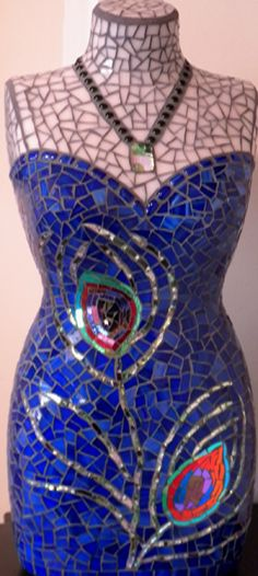 """Glassy Lady (2010) by Brenda Jolin of Winslow, ME  Materials: stained glass, colored mirror, ice jade tiles, dichroic cabochon, and glass gems   included is a steel stand measuring 9"""" x 12""""  Dimensions: 50 cm torso"""