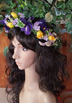 Purple and yellow flower hair wreath is a mix of royal purple iris, yellow rosebuds, light purple lilac flowers intertwined with veriegated green ivy make this floral crown... #wedding #bride #bridal #garter #hairpiece #weddings #ido #bridalcomb #veilcomb #crystalcomb ➡️ http://jto.li/UnpDt