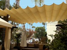 Slide on wire retractable awning in either white or yellow over fire pit for shade during the day.