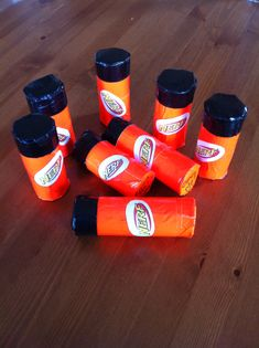 "Nerf party invitations, easy and fun!! I used toilet paper tubes, orange and black duct tape. I made invitations and put them inside the tube before I put on the black tape. They were a big hit! To open the tube and get the invite out, they will have to rip it open. I wrote in sharpie on the bottom, ""open me"""