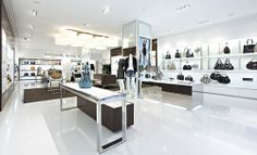 michael kors store interior,my favorite thing in this interior is the color white,white is very eye popping when it is surround with other dark colors,like shown in the picture above