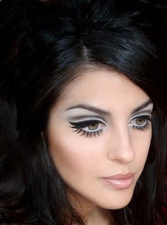 1960's Makeup - blue eyeshadow was worn alongside the false lashes to accentuate the eyes.
