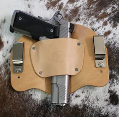 """The Bison"" Model Holster will hold sub-compact, compact to full size and 1911 style  pistols.  Same holster works for right or left hand draw. Leather Holster will break into your firearm. The most comfortable IWB holster. Securely holds your weapon in place. Hand crafted in the USA. Fits belts up to 1 3/4"".  Adjust cant and height by easily moving the screws. We use the best U.S. hides available.  Maintenance-free construction."