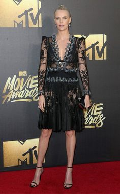 MTV Movie Awards 2016 Red Carpet | Charlize Theron in black lace pleat dress with plunging neckline and sandals | The Luxe Lookbook