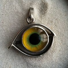 Glass Eye and Silver Pendant Mesmerizing