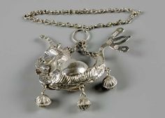 Baby Sam's silver rattle. In the form of a unicorn, with fish tail and three bells on a chain. The bells were said to ward off evil spirits. SALT REDUX