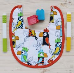 Cotton bib with parrot fabric for baby girl and baby boy. This cute bib is a great fashion accessory for children and is hand made with love